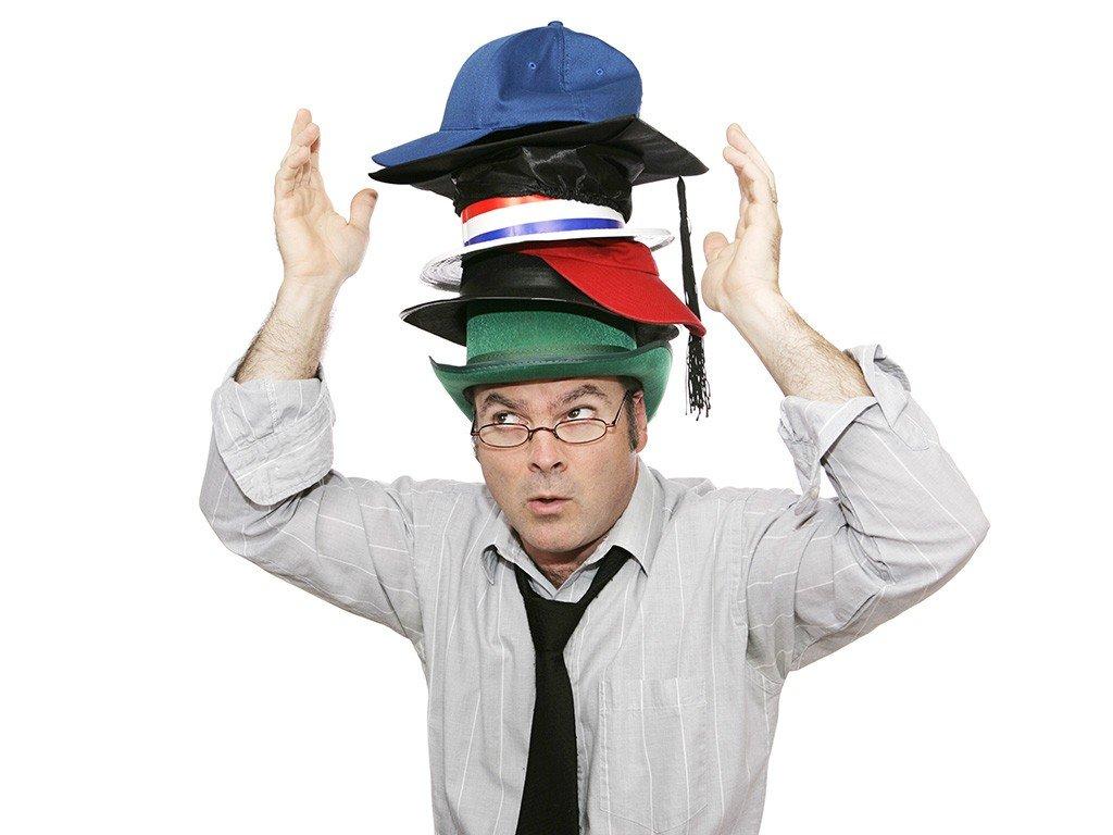 man-balancing-hats