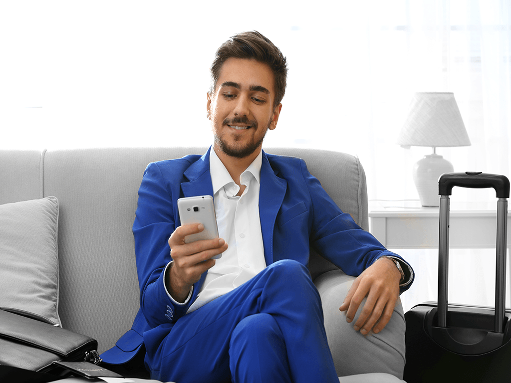 man-in-blue-suit-with-cellphone